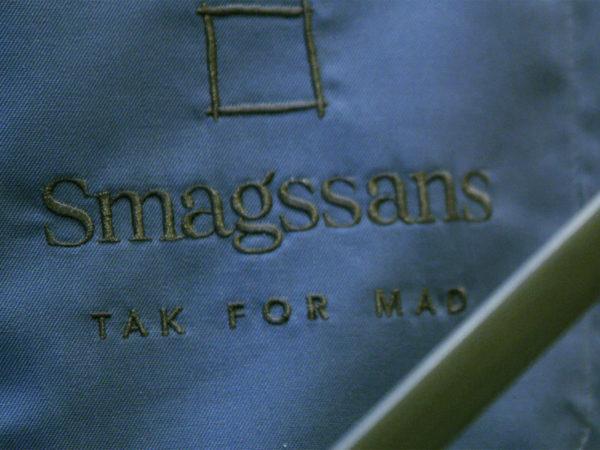 Smagssans logo på forklæde